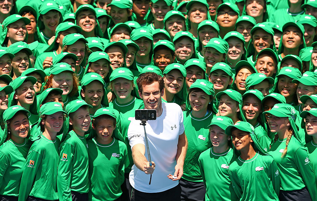 MELBOURNE, AUSTRALIA - JANUARY 12:  Andy Murray of Great Britain takes a selfie with ballkids from Australia and overseas during the annual ballkid team photo ahead of the 2016 Australian Open at Melbourne Park on January 12, 2016 in Melbourne, Australia. The Australian Open 2016 ballkid squad is comprised of 329 ballkids from Victoria, 25 ballkids from interstate and 30 ballkids from overseas including 20 from Korea, six from China and two from Singapore.  (Photo by Scott Barbour/Getty Images)