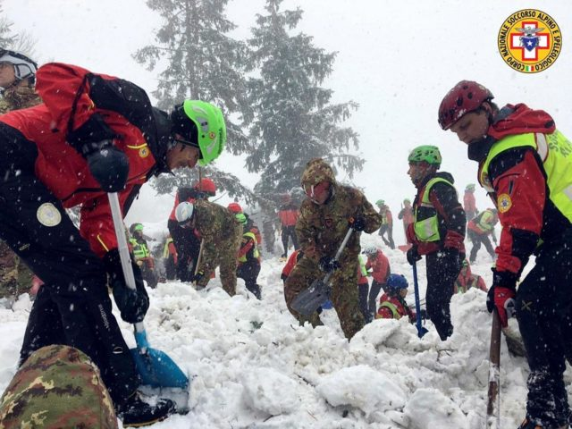 Rescue workers search in snow around the Hotel Rigopiano in Farindola, central Italy, which was hit by an avalanche, in this January 21, 2017 handout picture provided by Alpine and Speleological Rescue Team. Soccorso Alpino Speleologico Lazio/Handout via REUTERS.ATTENTION EDITORS - THIS IMAGE WAS PROVIDED BY A THIRD PARTY. EDITORIAL USE ONLY. NO RESALES. NO ARCHIVE.
