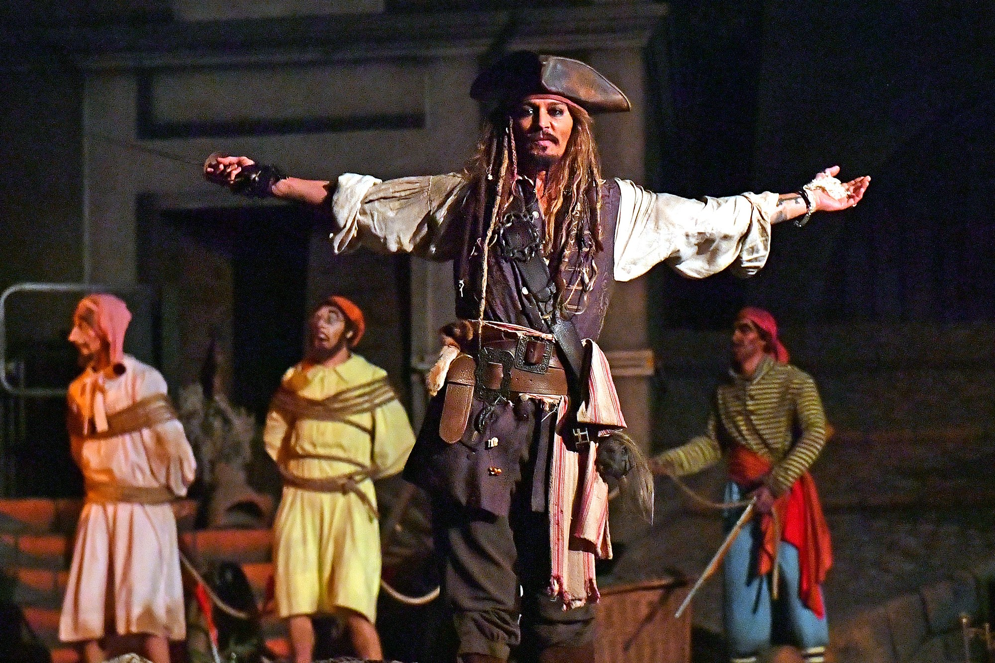 """EXCLUSIVE: ActorJohnny Depp stunned fans on the Pirates of the Caribbean ride at Disneyland last night (wed) - by making a surprise appearance dressed as Captain Jack Sparrow. The legendary actor wore his trademark Pirate outfit as he shocked delighted theme park guests as they sailed past him in boats. One onlooker told E! News: """"Everyone was surprised, shocked and excited to see him. He acted exactly like his character in the movies. Johnny could be heard speaking in his trademark Jack Sparrow accent and waving a sword as visitors to the resort in Anaheim, CA, laughed and looked on. The star's appearance came as he gets ready to appear in the fifth installment of the blockbuster franchise: 'Pirates of the Caribbean: Dead Men Tell No Tales'. 26 Apr 2017 Pictured: Johnny Depp. Photo credit: Snorlax / MEGA TheMegaAgency.com +1 888 505 6342"""